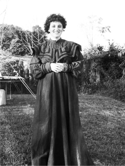 Becky Helton, who played the part of Elizabeth Cooley McClure, wore a dress which was actually made by Elizabeth Cooley. Elizabeth Cooley also spun the wool and wove the material in the dress. Photo by Susan M. Thigpen.