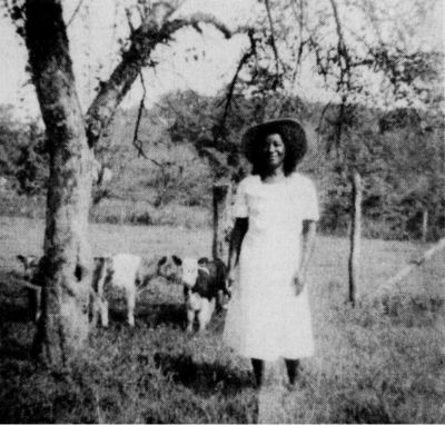 "Mary Tidline at age 54, with some of her ""pet"" calves."