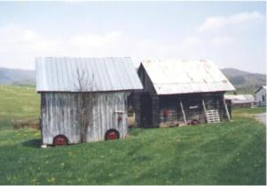 A view of the unique construction of the corncrib ( the building on the right). It had a pull-through for a wagon. The building on the left is a granary.