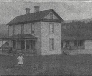 "1911 photo of the overseer's house. Ethel Swanson Crigger, daughter of William Albert and Annie Elizabeth Cassell Crigger, born June 17, 1908 and died February 28, 1912. Her parents worked for the Poorhouse Farm and lived in one of the two tenant houses. William later became the caretaker of the Farm after Crenshaw retired in 1930. William and Bessie Crenshaw did not have children of their own and loved little Ethel dearly. When she died in 1912 at the tender age of 3 1/2, it must have been a sad time for everyone at the Poor Farm. Ever since, you can hear the sound of a child playing around the farm. When asked if there are ghosts at the Poor Farm, Sarah Graham says, ""No, no ghosts . . . but angels . . """
