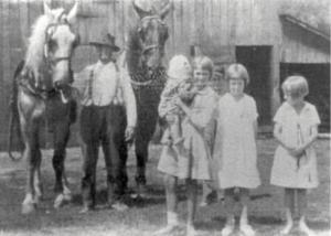 The Poor House Farm barn is in the background in this 1922 photo of William Crigger holding the horses Dick and Dan. Pictured from left to right: Pearl Cassell holding baby Mary Lee Moore, Crigger's young son Allen (holding one of the horses), Isabel Dean Johnstone and sister Virginia Vance Johnstone on a visit with their Aunt and Uncle, the Crenshaws.