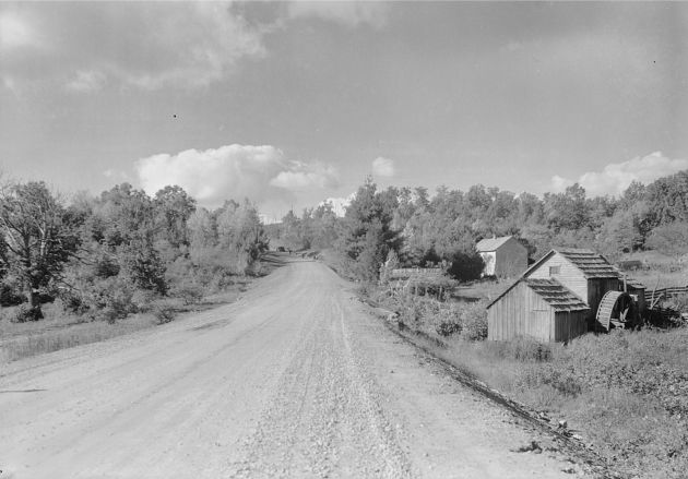 View of the Mabry Grist and saw mill before the NPS dredged the pond and razed the Mabry House in 1947, replacing it with the Matthews Cabin in 1956-57. Photographer Unknown. Date: 1938.