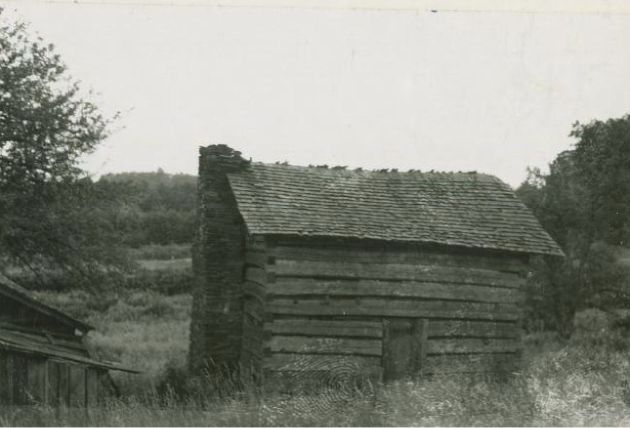 "Image shows a wood cabin with a stone chimney on the left side, belonging to Boyd or Hubbard Miller. A second structure stands to the left side of the cabin. A note on the card says, ""Reasonably sure this is cabin at road leading to Rocky Knob Cabins."" Image taken by Thor Borresen in September 1941."