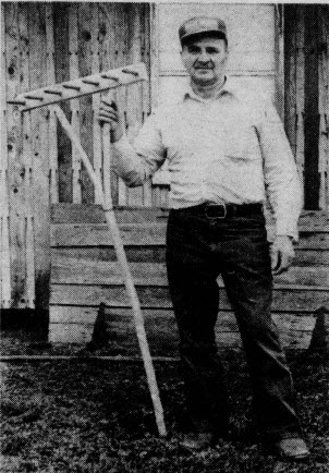 Glendon Boyd with one of his handmade rakes.